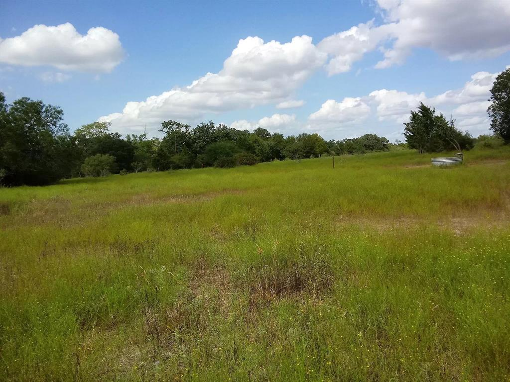 Open House rescheduled to Monday/9/28/20 11am-4pm or, by appointment.    Convenient location to Victoria, Yoakum, Edna, Gonzalez, Hallettsville, and Cuero (Hwys 77&111)!  Fish in the pond or build a home on this Ranchette and settle into your peaceful place on earth.   Shade and breeze on the front porch is just right for rockin' chairs. Sixty two acres has 2bedrms, 1bath farm house with large kitchen and permanent stairs to attic. Majority of land is pasture with trees, with several locations for lovely homesites. 'Usually dry' Branch