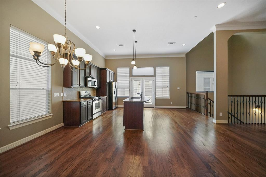 The main living space is entirely open. Making this space great for entertaining. Real hardwood floors stretch throughout this gorgeous space.