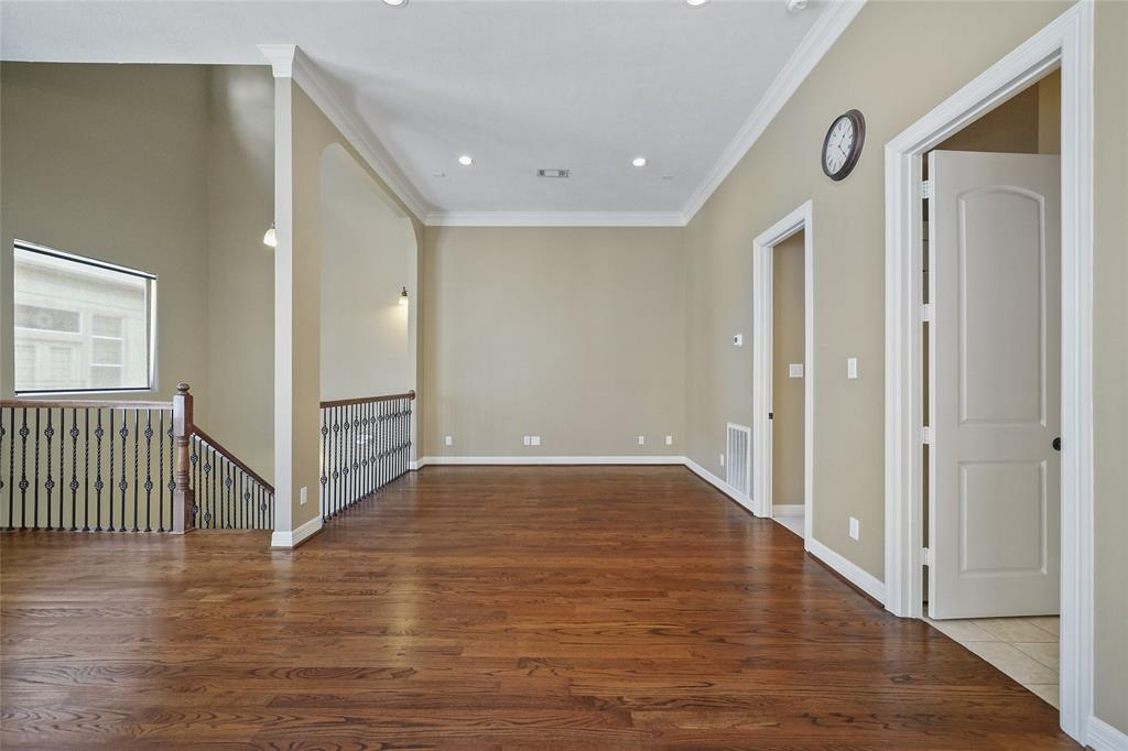 The main living space also includes recessed lighting, high ceilings, and crown molding.