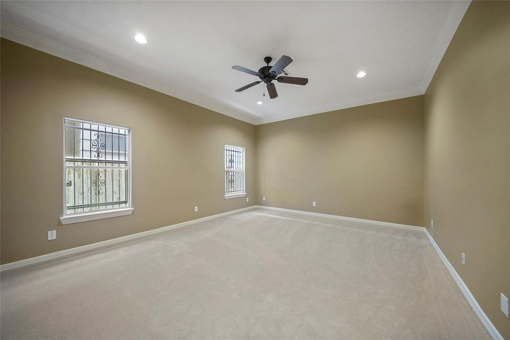 This large downstairs primary bedroom is located on the first floor and features new carpet.