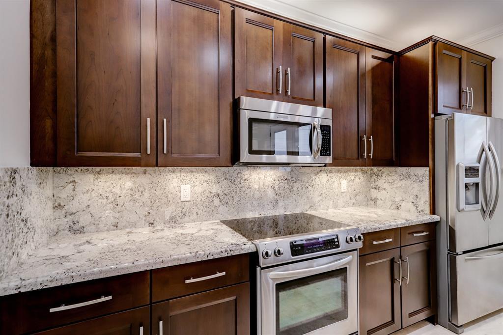 No expense was spared including the solid granite backsplash and elegant cabinet hardware.