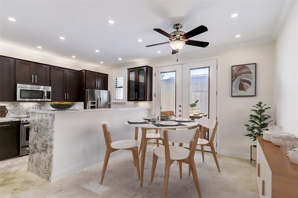 The dining area will readily fit a round or rectangle table, as well as a sideboard. (room is virtually staged)