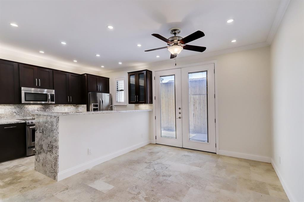 Depending on the dining room furniture configuration, there's also a long breakfast bar for stools. The french doors lead directly to the patio, then garage.