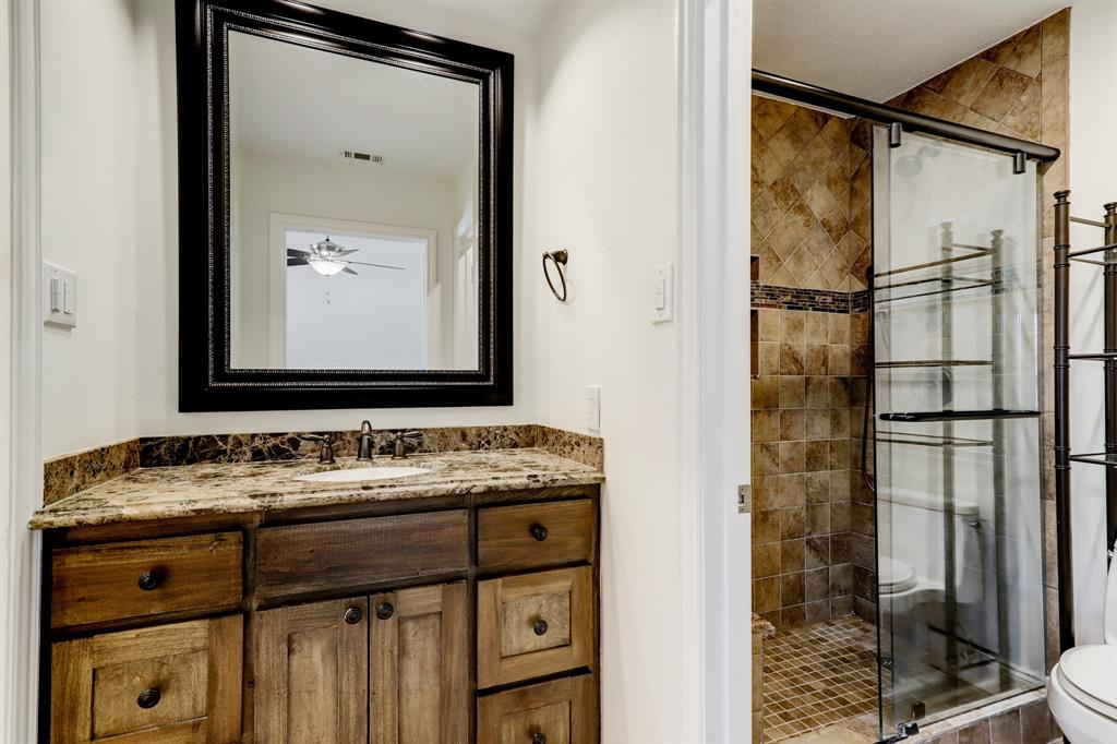 The richly updated primary bath includes a private WC/shower room.
