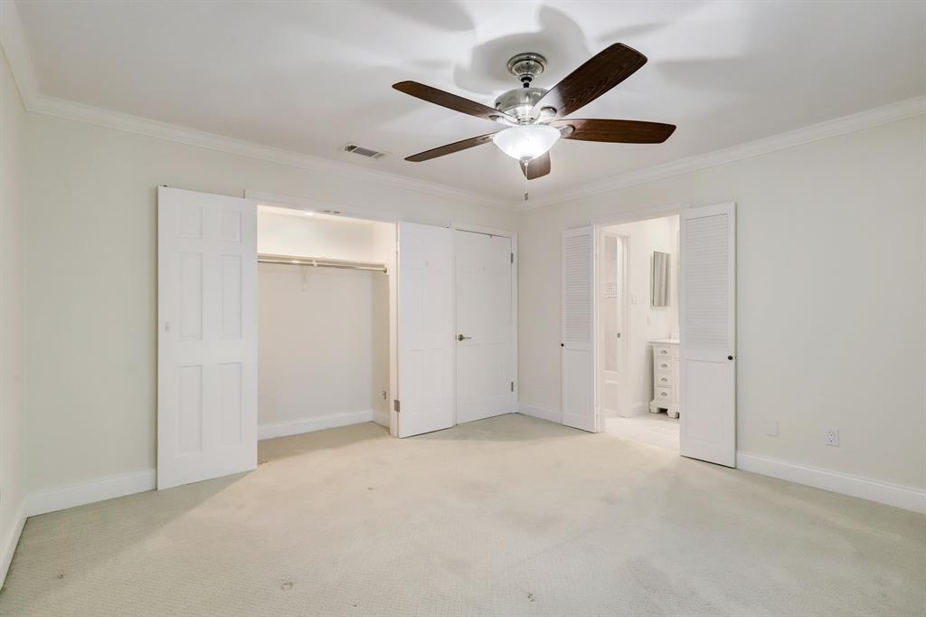 This bedroom also has standard and walk-in closets. The closed door leads to the hall at the top of the stairway, which separates the bedrooms (no shared bedroom walls within the unit).