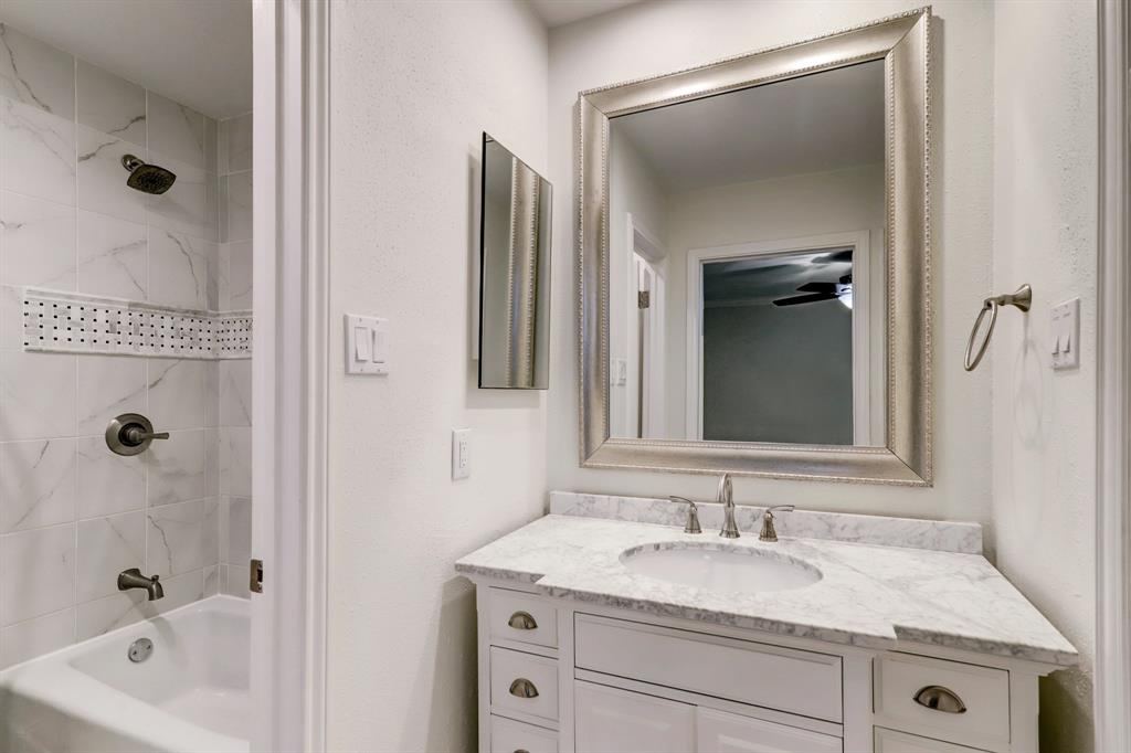 The second bedroom's full bath has also been updated, and includes a private WC/shower room.