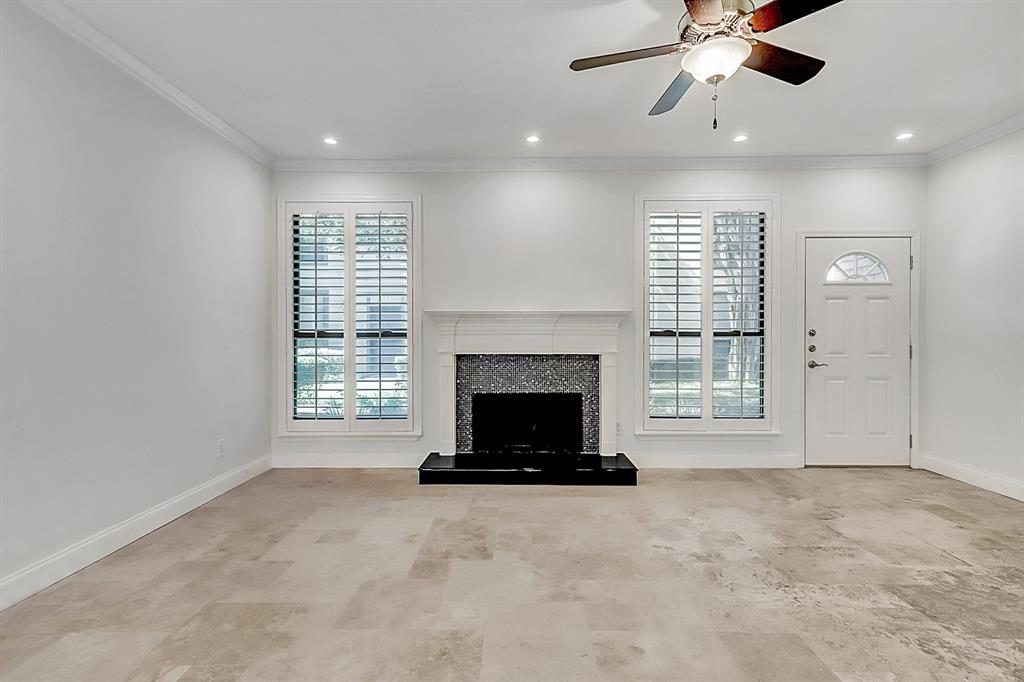 Beautiful 18 x 18 travertine floors run through the first level of this very gracious and comfortable home.
