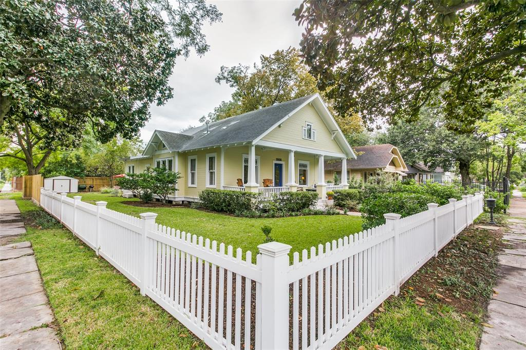 Fantastic renovation/expansion of this 1915 Arts & Crafts bungalow in the Houston Heights Historic District. Carefully restored in 2019-2020, preserving historic design elements, while creating a modern, luxe home to function perfectly for today's living. Picture-perfect setting on oversized corner lot, complete w/ grand magnolia tree & white picket fence. Large welcoming front porch. Inside, find restored living room, dining & study/music room, antique pine floors, mullioned windows, milled beams & trim. Delightful kitchen features pantry, quartz counters, island, SS appliances including Wolf range & breakfast nook. This opens to bright family room w/ gas fireplace. Spacious 1st floor primary suite features incredible bespoke closet & lovely marble/granite bathroom. Upstairs are 3 charming bedrooms, full bath & game room (or workout, office). Back downstairs, a screened porch overlooks the expansive fenced back yard w/ alley access & room for a pool!