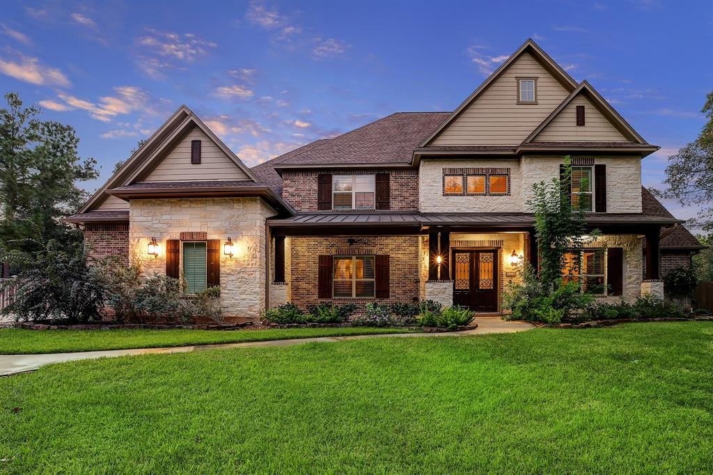 Nestled on a sprawling .75-acre cul-de-sac lot surrounded by mature trees, this gorgeous custom home boasts an open concept with soaring ceilings, expansive windows, crown molding and plantation shutters. An enormous kitchen features large breakfast bar, abundant cabinetry, butler's pantry, huge walk-in pantry and gas cooktop. Kitchen flows seamlessly into a spacious living area with stunning floor-to-ceiling fireplace, handsome wood beams & built-ins. Property offers ideal work-from-home accommodations for 2 with a study & flex room with built-ins. Fabulous owner's retreat & en suite guest bedroom are downstairs; all bedrooms up boast en suite baths & large closets. Outdoors, massive yard has plenty of room for a pool, & the substantial covered patio is ideal for entertaining and relaxing. Rare 3.5 car garage provides room for workshop. Home features loads of storage including a sizeable Texas basement and multiple staircases. Very low tax rate! Zoned to excellent Woodlands schools!