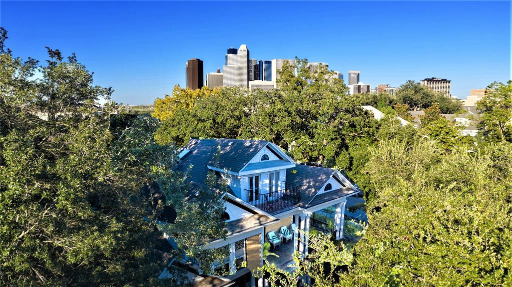 3 PROPERTIES IN ONE.  Primary residence is a STUNNING 1913 3 Bed/3 Bath Montrose historic showplace w/wrap around front porch, grand entrance, soaring ceilings, hardwood floors, 2 fireplaces, & incredible original detail throughout.  Located in the Avondale East Historic District, this residence features splendid interiors & exquisite old world craftsmanship.  Completely updated blending historic charm w/ Scandinavian contemporary style.  Enormous Master Suite fills entire second floor & has a charming balcony looking into the tree tops.  Beautiful second residence is 1000+ square foot 2 Bed/1 Bath + Study garage apartment w/ its own private entry.  In addition, the property holds a 300+ square foot studio/efficiency w/ bathroom & kitchenette which could be used as guest quarters, work studio or additional income producing property.  The 6240' corner lot is completely fenced & front yard is a beautifully landscaped oasis.  In heart of Montrose – walking distance to over 24 restaurants.