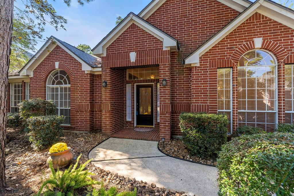 This one-story Woodlands home is walking distance from Powell Elementary, The Woodlands High School, Capstone Park, and just around the corner from the golf course. The exterior of this home is brick all the way around with a detached garage and long driveway. Step inside to two versatile front rooms, an art niche, and french doors leading into the living and kitchen area. This kitchen features a gas range on the island and plenty of natural light through the garden window over the sink and bay window in the breakfast nook. Just outside is a large covered patio space with pavers leading to a the perfect spot for a sitting area. Crown molding, built-in shelving, and a walk-in laundry room are just a few impressive traits of this home. Come see for yourself!