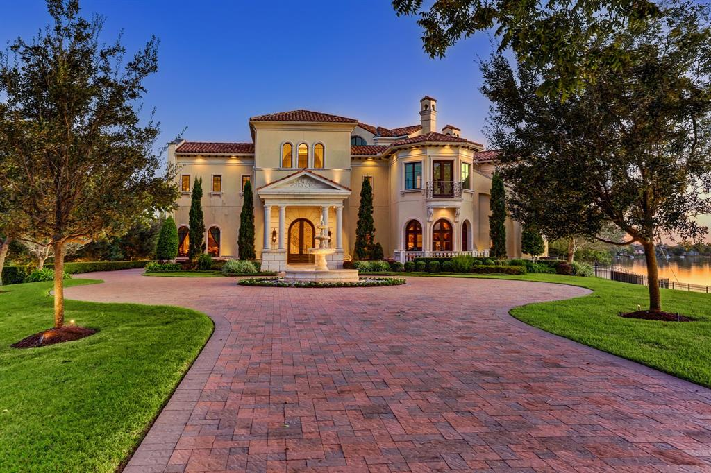 Exquisite custom waterfront estate located on 2.13 acres (per FBCAD) on exclusive Alkire Lake in Sugarland, Texas. This palatial 13,072 SQ FT (per appraisal) home sits on its own private gated peninsula surrounded by water on three sides w/ picturesque views from every room. Grand entry features custom iron door, sweeping marble staircase & tall ceiling w/ stunning crystal chandelier. Open floor plan designed for entertaining offers an opulent formal space w/ plenty of windows & amazing lake views, large dining room, island kitchen which opens to family & breakfast area, two offices, exercise room, first floor primary suite w/ luxurious bath & two huge closets, second primary suite on the first floor, sophisticated upstairs game room, media room, lavish secondary bedrooms each w/ their own balconies and en suite baths & 3 car garage & Porte Cochere . The incredible outdoor space features a resort style infinity swimming pool w/ spa, outdoor kitchen and fire pit. All info per seller.