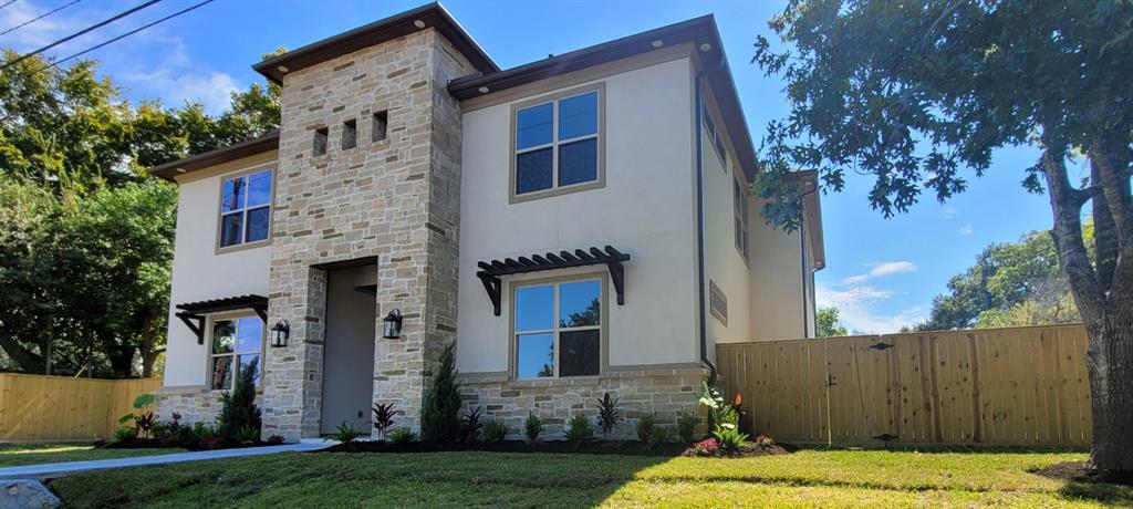 "Stunning NEW CONSTRUCTION 2 story home features a grand entry with high ceilings. An oversized chef's kitchen includes Kitchen Aid stainless steel built-in microwave and oven, 36"" cooktop and dishwasher. Large kitchen island with quartz counter tops and undermount stainless steel sink, Under cabinet lighting and large walk in pantry. The open concept Living and dinning room looks out to the extended covered patio with stone column. A luxurious master bath includes a jacuzzi tub, double shower, His and Hers vanities and an amazing master closet.  Iron gate with remote control and plenty of outdoor space on both sides of the house."
