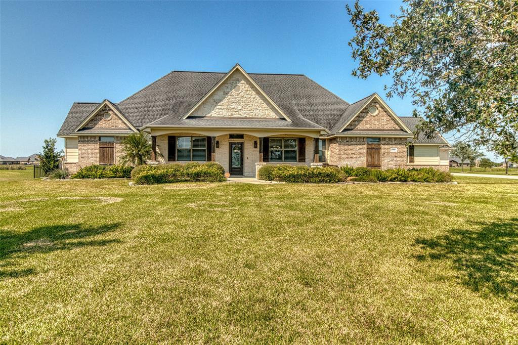Beautiful Custom Home set perfectly on +/- 1.20 acres, and backed up to the community lake with awesome views. This wonderful home is loaded with space where it counts. With +/-3148 square feet, and everything on the ground floor except for the fabulous game room and full bath, that could double as a second primary bedroom upstairs if needed. The spacious family room is open to the kitchen, breakfast and formal dining. The cooks dream kitchen is massive with loads of work area and an island. Loaded with custom cabinets, beautiful granite and stainless appliances. The master suite is in the back of the home with executive style en-suite bath, and walk in closet. There are two other secondary beds down with a Jack and Jill bath between them. There is a spacious mud/utility room off the garage with access to the back yard and the adjoining half bath close by. Check out the great workshop/third garage and the huge pre-plumbed outside covered patio, with room to design your outdoor kitchen.