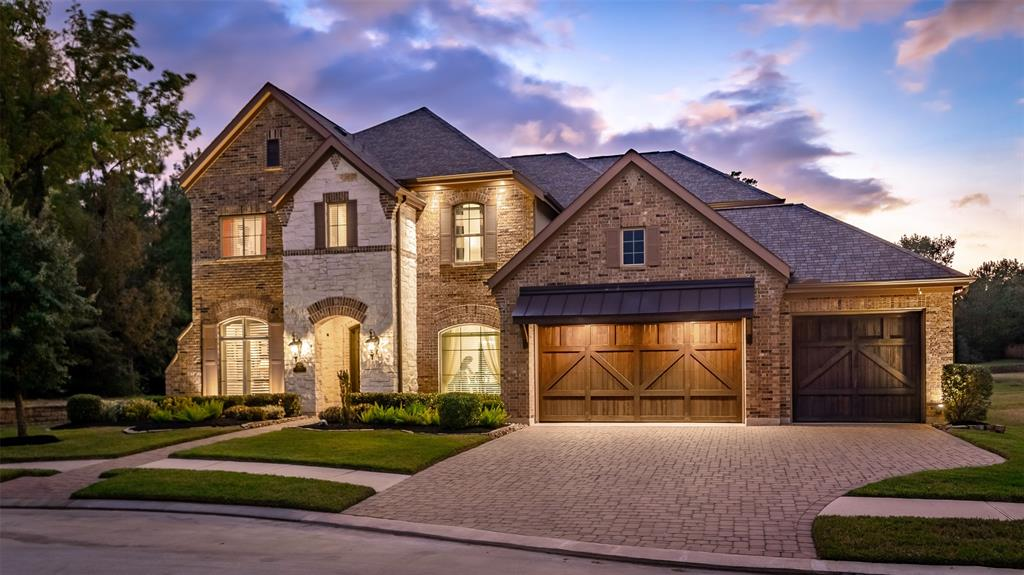 Welcome to 1018 Oak Summit Lane, in the exclusive gated community of Oak Estates at Jacob's Reserve. This lovely home has room to work, study and play at home. With 4 bedrooms, 3 1/2 bathrooms, a gameroom AND a theater room, everyone has space and room to roam. Over $125,000 of upgrades make this home ultra-special! A Massive 19 foot ceilings in the main gathering room with floor to ceiling windows make the open floorplan light and bright. Remote control blinds are available to cover them when privacy is desired. Savant Home System with lighting and speaker package, beautiful hardwood floors on main level and in upstairs gameroom, ceiling fans in all bedrooms, Nest Thermostats, Ring Doorbell, oversized garage with 4 spaces, outdoor kitchen, theater room equipment and outdoor soffit lighting are just a few of the home's upgraded features. Greenbelt preserve sits on one side of home. Perfect flat backyard for a pool if buyer wishes (prewiring is done). Your dream home awaits!