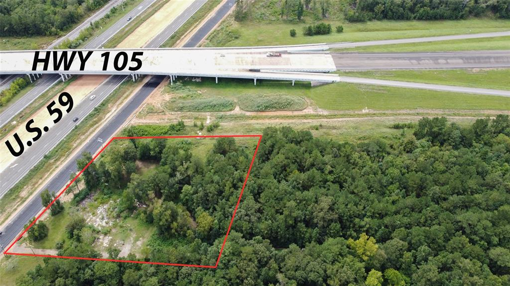 PRIME LOCATION!!! This lot is situated on the perfect corner for a gas station, restaurant, or any thriving business. There are endless possibilities on this 1 ACRE lot on the corner of US-59 and SH-105 Bypass. The highway recently went under construction to add the new and improved frontage road for easy access. This lot was used as residential in the past and can be used as residential or commercial. It has electrical and water well. This area is growing rapidly!!
