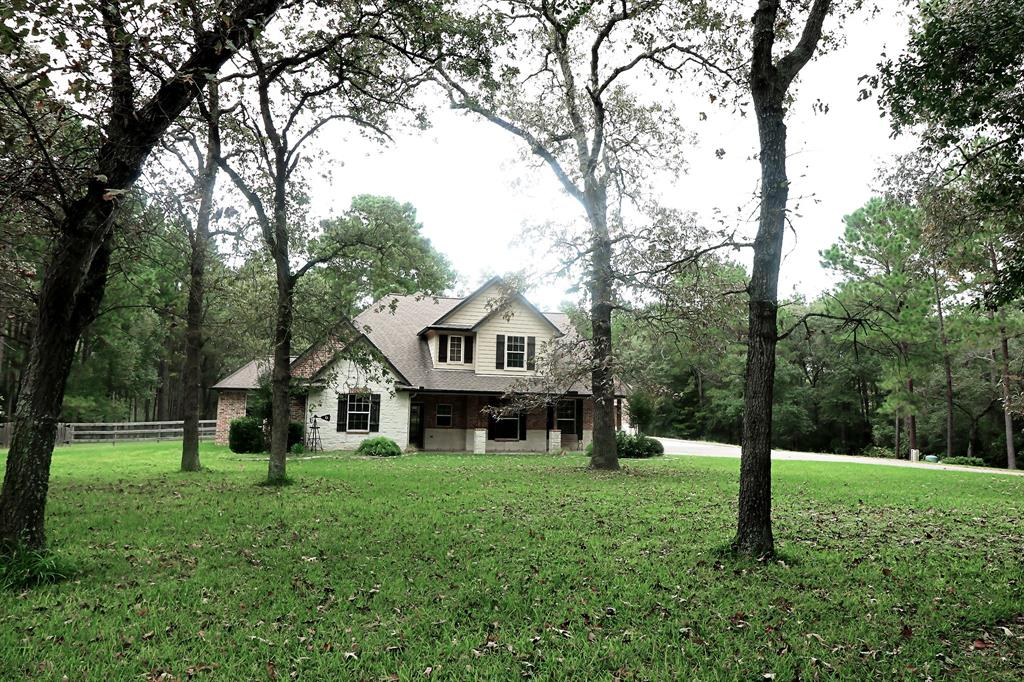 Too many great features to list, this is a must see custom built home on 5 acres in the private & secluded gated subdivision Century Oaks. This homesite is perfect, cleared for the home and still wooded to offer privacy, stocked pond for anglers and a backyard with wildlife and serenity. Bring your horses too! The home has a 2 car garage with an added RV storage that is currently being used as workshop/plenty of space for more cars, classic cars, man cave, etc. Now we can talk about the interior, mesquite wood floors greet you in the entry way and lead to a spacious family room. Custom built ins, reclaimed wood wall panels, handmade cabinets, pre-wired for speakers throughout. Huge kitchen with granite countertops, stainless steel appliances. The home has 4 bedrooms & plenty of space to customize to your family needs. Texas basement for storage can be finished, great for additional room, gym, craft room, oversized closet.  So much space to fit all of your needs. Contact for showing!