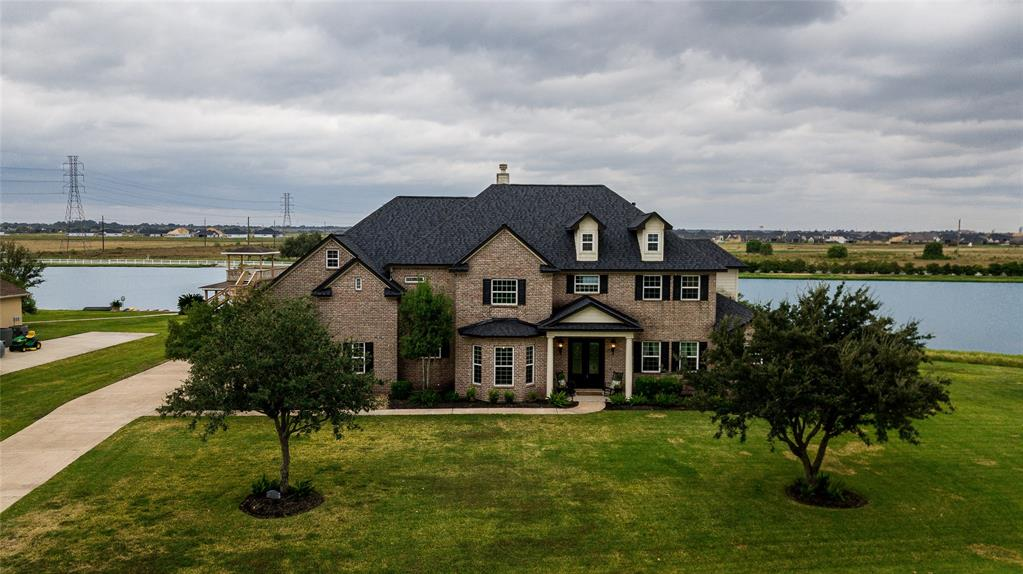 Welcome Home to Lakes of Katy!  Are you ready to jump on the boat after a hard days work? Great - This is the home for you! Just walk out your backdoor & hop on your boat that is located on your private boat house & boat lift.  This community has 4 interconnected lakes available for boating, swimming, paddle-boarding, and kayaking creating the perfect location for those who love water-sports. However, you will be located on the best lake in the neighborhood - deepest & widest lake with the ski jump right out your back door. The open concept of this home provides for an entertainer's dream. You will find 5 bedrooms, 3 1/2 baths, and an oversized game room that can double as a bedroom. This gated, private community is zoned to Katy ISD & is only a short commute to the big city. Brand New Roof!!  Newly laid sod!! Low Taxes!  No MUD! Are you ready for your lifestyle change?