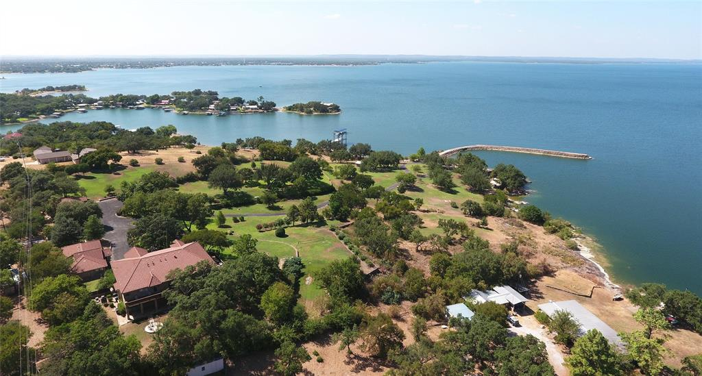Absolutely stunning Waterfront acreage.  Approximately 1,000 feet of deep water front on the main basin of Lake Buchanan.  10 manicured acres along with 600' long concrete jetty leading to deep water make this an incredibly unique and amazing opportunity for a family compound.  Immediate income from current Airbnb rentals.  With no restrictions this would also make a spectacular event/wedding venue or corporate retreat.  There is a 7,000 square-foot main home along with guest homes, cabana, boathouse, launch and private beach.  Excellent access off Highway 29 between Burnet, Llano and Kingsland.  Less than 90 minutes from downtown Austin.