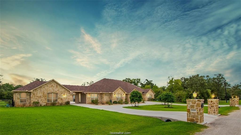 "One of a kind Country living that maximizes privacy only 20 minutes from Bryan/College Station! This property offers it all -- 1.65 acres, a gorgeous 5,262 sq ft home, salt water pool & spa, 1,200 sq ft 4-car garage, detached office space with full bath, & so much more! The Ranch style home offers a split floor plan with 5 bedrooms, 4 full baths, 2 half baths, study, Game room, media/Theater room & guest/MIL suite with kitchenette, separate laundry area & living/dining space. The gourmet kitchen is a Chef's DREAM with commercial grade stainless appliances, granite countertops and custom cabinetry. The spacious master suite has a HUGE walk-in closet, with its own laundry room and mini kitchenette. NO expense was spared on the outdoor living space which features an extensive covered patio with outdoor kitchen, a pool/spa with a gorgeous rock waterfall. This is the ""forever home"" that you've been searching for - Call for your private tour TODAY!"