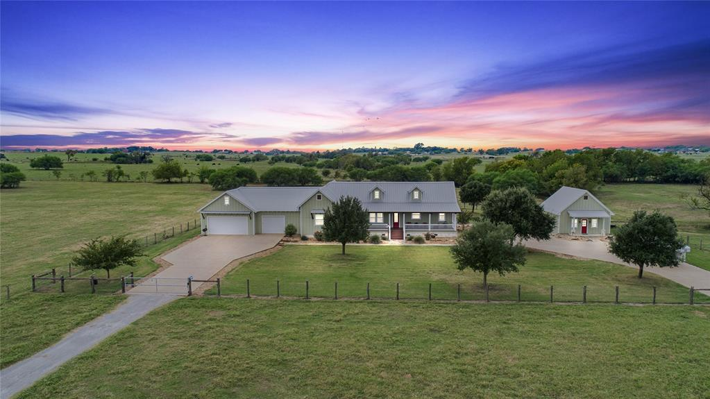 Stunning 63 acre ranch located only 10 minutes from Texas A&M! This tract combines the conveniences of town with the quiet surroundings of the countryside. Secluded towards the back of the land sits this builder's personal home. No expense was spared including all shiplap walls, pine flooring, exposed beam ceilings, stainless appliances, double oven, warming drawer, granite countertops throughout, oversized laundry room, & an insulated 3+ car garage. The back porch includes a rock fireplace & great views of the surrounding land. Other improvements include a 720 sf. 1 bed/1 bath bunkhouse, 24'X32' barn w/ 2 roll up doors, bathroom, and covered working pens. The land features a 25' deep stock tank w/ dock, one additional tank, improved pastures with Tifton 85 & sandy loam soil, recently done perimeter and cross fencing, Wickson Water to the home, and additional water well supplying water to all the pastures. Come see everything this immaculate property has to offer.