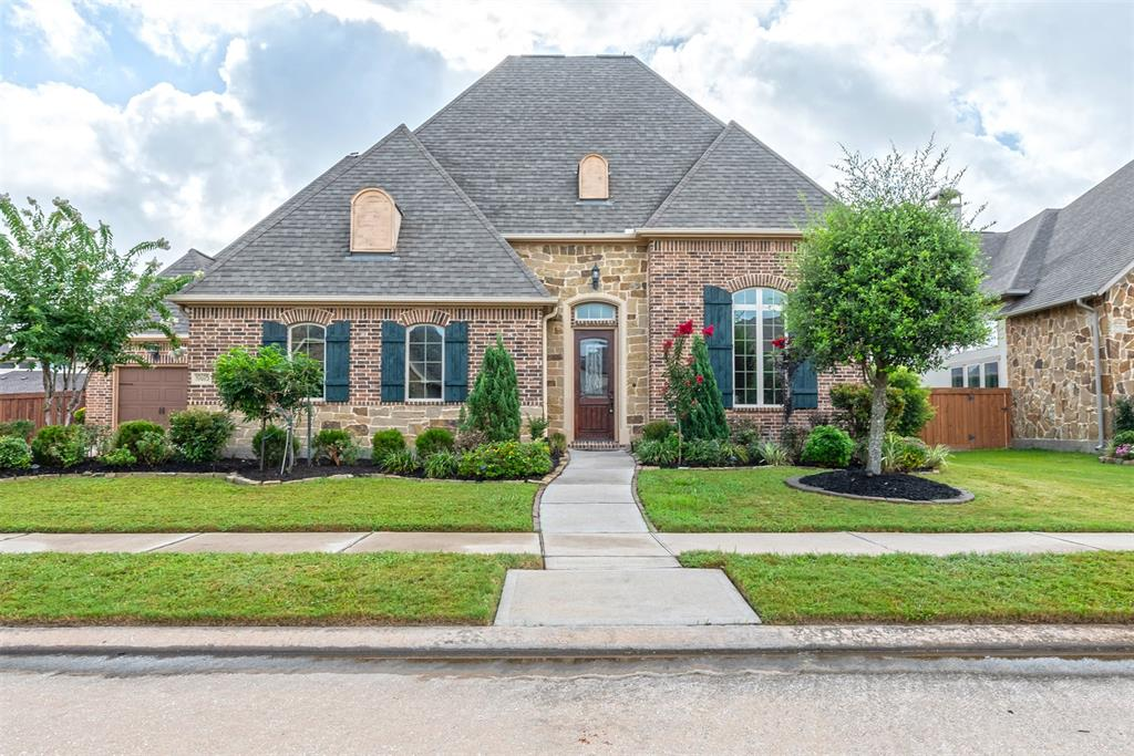 Nestled in the highly desired Aliana Master Planned Community is this 4BR, 3 bathrm, 2 half bath luxury home on a spacious lot. The unique 1.5 story property has a furnished media room with projector screen, game room with a pool table, and half bath on the upper level. The first level has sleek wooden floors throughout the entry, office, dining rm, family rm, 4BR and 2nd half bathrm. The gourmet kitchen has gorgeous cabinetry and is attached to a walk-in butler's pantry. From the floor to the ceilings, no details were left out. The rms are adorned with high baseboards, crown molding, arched hallways, and recessed ceilings. The home also has a 3-car garage, 2 attached, and 1 detached. The relaxing back patio is extended and fully covered with an outdoor fireplace. The property has mature fruit trees throughout, and is near a peaceful walking trail and pond. Residents enjoy many amenities, including the resort style pools, and access to two fitness centers, tennis courts, and clubhouses