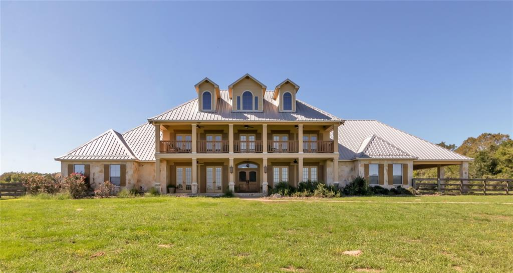 Experience luxury living just 20 minutes from College Station and Texas A&M! Hidden Castle Ranch is quiet, private estate that sits among the beautiful rolling hills of Central Texas.The main house boasts 5,400 square feet of living that features a luxurious first floor primary suite complete with sitting room and private fireplace. Upon entry, you are greeted by a hand-carved red oak staircase that is truly a statement piece. Incredible sunset and sunrise views over the property are viewable from the second floor balcony.  Hidden Castle Ranch also includes its own magnificent barn and surrounded by pristine horse pastures. The barn includes 4 oversized stables designed by the seller, tack room, a 2,400 square foot safe room, and large guest house.  Two ponds and nearby Davidson Creek provide an abundance of wildlife habitat and fishing opportunities. Can be sold with an additional 190+/- acres which can be subdivided.  Please view the 3D virtual tour and attached floorplans!