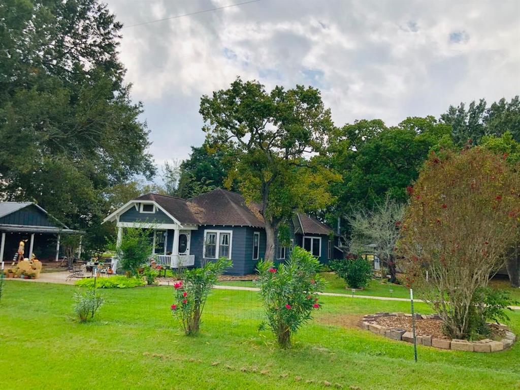 Your perfect home in the country is ready for you! Country living w/short commute to I10, dining, shopping in nearby Katy. Situated on 2.1 acres. It has 2 houses, huge fully insulated shop/office w/AC. 2 car det garage. Main home is 2,422-SF, 3bdr/2ba, home built in 1929 W/addition in 2010. Original shiplap walls! Guest house completely renovated 2018.Owners invested over 150k in upgrades/renovation into property since purchasing in 2015! 1200-sf 1/1. Can be used as  income property/guest home. Barn/Workshop 60x30 metal bldg w/concrete floors, approx 800 sf finished w/drywall, drop ceiling, industrial wash tub sink with 8 ft sliding barn door to insulated 1000 sf work area. 2 AC wall units 10 ft roll up door. Can used for business, recreation, ultimate man cave. 30x25 covered wooden deck w/RV hookup. Shop has lean-to barn with 3 stalls. Old barn in the back of the property W/ walk-in chicken coop. Property has 3 adorable registered miniature donkeys; can convey to buyer. Horses Allowed