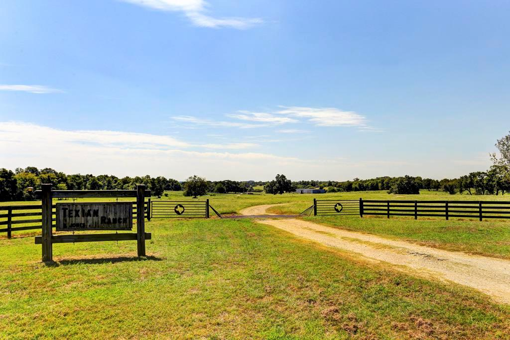 The 173+ acre idyllic Texian Ranch is located on Hwy 290 with  a secluded home tucked in the back 80 acres over 3000 feet off the hwy.  Between Brenham and Chappell Hill. Rolling pastures with trees, fishing lakes, abundant deer, a running creek, and bluebonnets. One hour from Houston. Stately 4300 SF home with pool, log cabin, sprinkler and fire pit in fenced yard. Cross-fenced for cattle. Large 6000 SF barn with water and electricity, workshop, pens. Agricultural exemption and 1/2 Mineral rights.