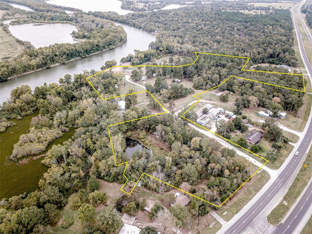 RIVERFRONT with Highway Frontage!!  18+ acres fronting the Trinity River with frontage on State Highway 19 offers great development opportunity.  Formerly Bell's Camp Marina, this property still has the original marina building near the water.   Property is mostly cleared with scattered clusters of trees.  Frontage along the Trinity River; property abuts Hwy 19 at 2 different points.   Conveniently located near Trinity, Riverside, and Huntsville.