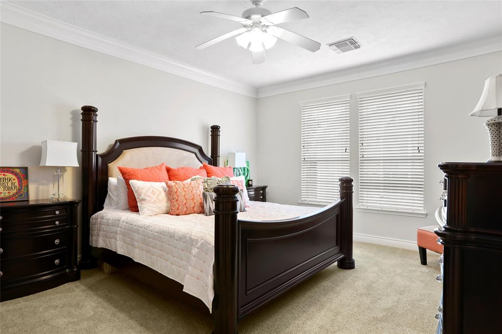 This king sized bedroom includes crown moulding and fresh paint. The master suite also has 2 walk-in closets.