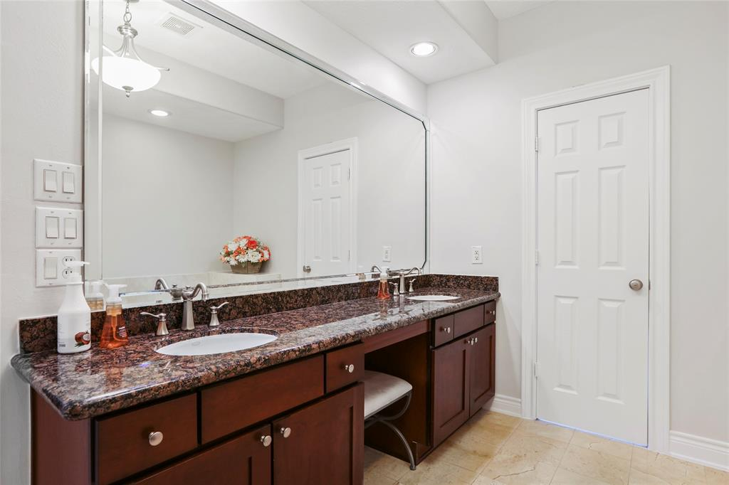The master bath vanity includes granite counter-tops, fresh paint (Oct 2020), double sinks. recessed lighting, and a huge mirror.