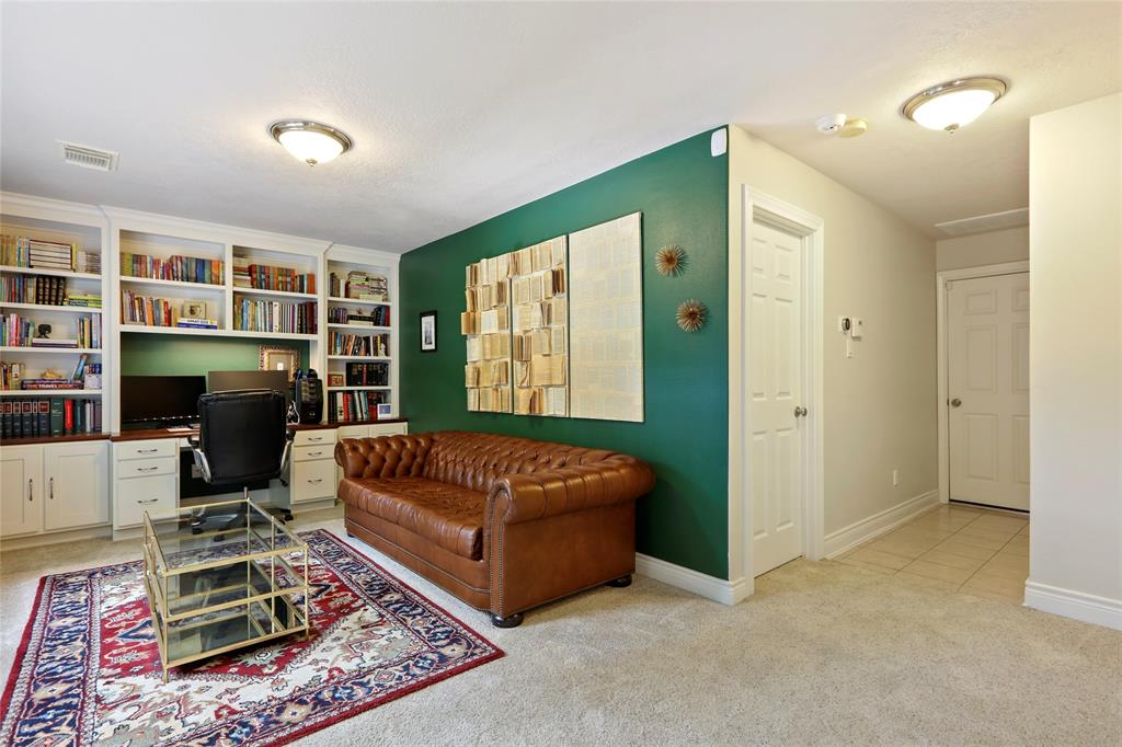 The downstairs study is large enough that it can serve as a second living area or a roommate suite. The built-ins provide a great study space.
