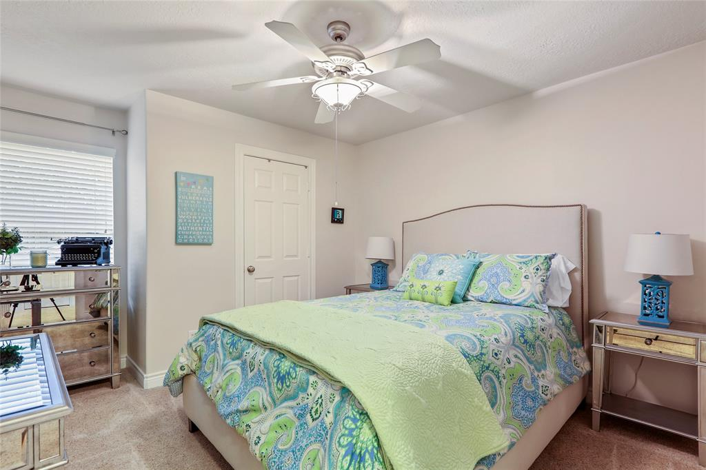 This large guest bedroom is located on the first floor. It has great storage.