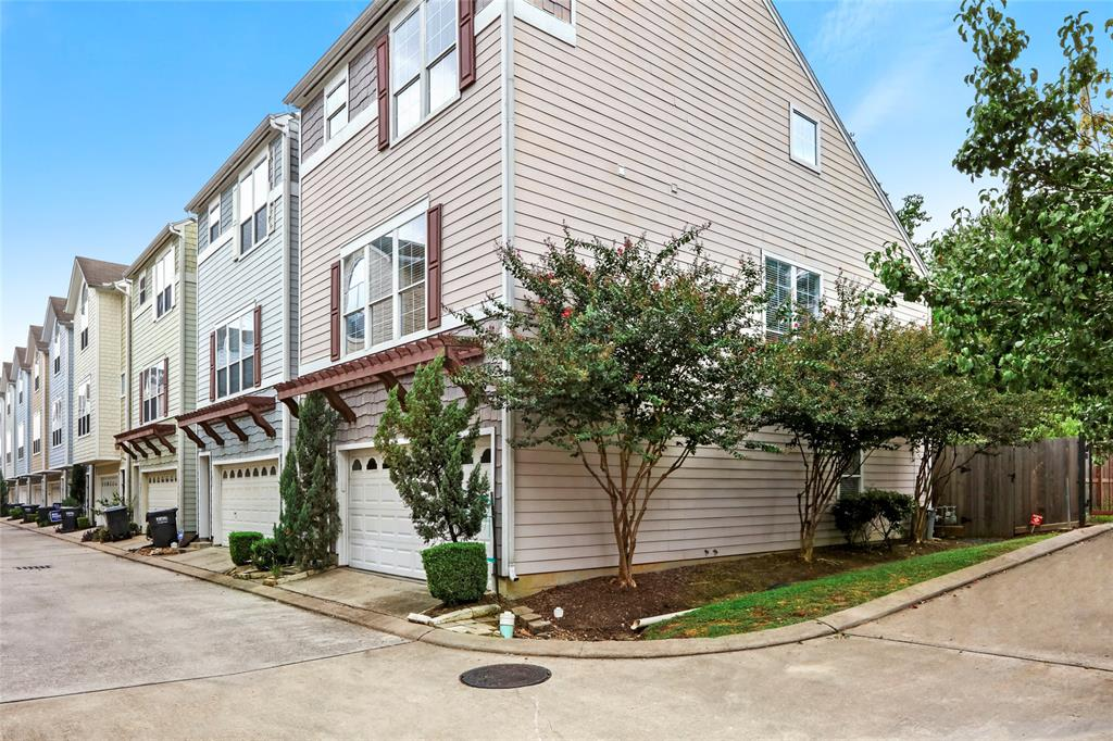 As a corner unit, this home has a lot of great natural light. Also, when looking out the side windows, you are typically looking out on these mature crepe myrtles instead of another home. Per the seller, the HOA currently allows curb parking along the side of the home.