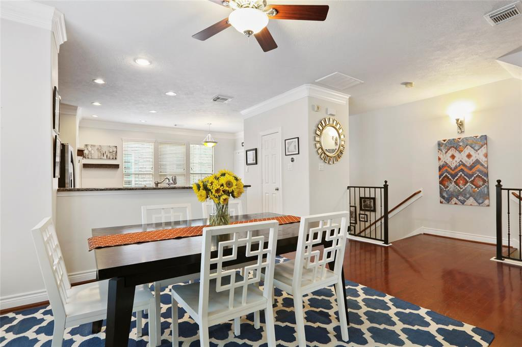 Kitchen opens to the dining room and includes recessed lighting and hardwood floors.
