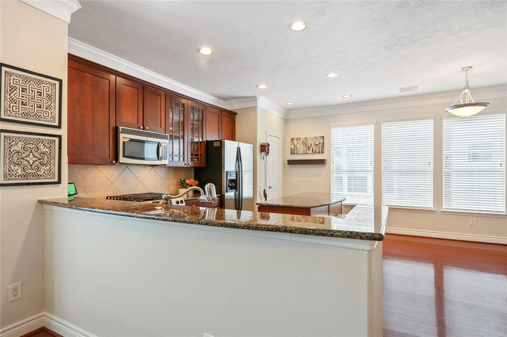 Bar high counter area provides a great space for entertaining. Kitchen also includes a separate breakfast area.