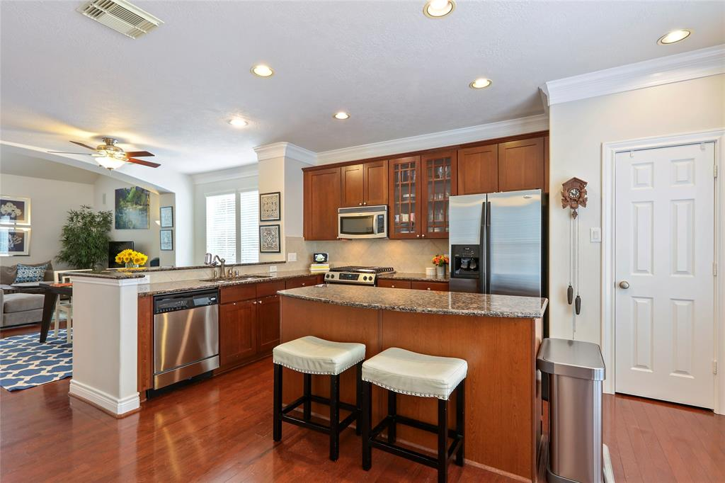 The kitchen includes stainless steel appliances, granite countertops, breakfast bar, and large pantry.