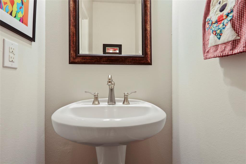 This half bathroom is located on the main living floor.