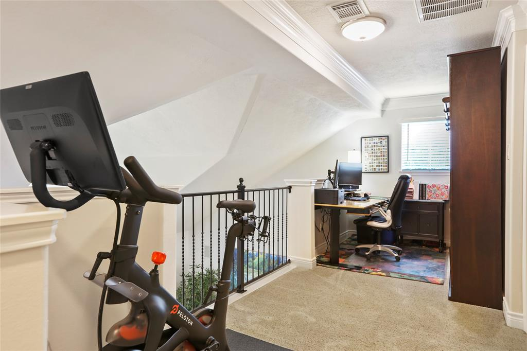 This multipurpose loft area is located off the master suite. There is plenty of space for either a workout area, study, or play area for the kids.