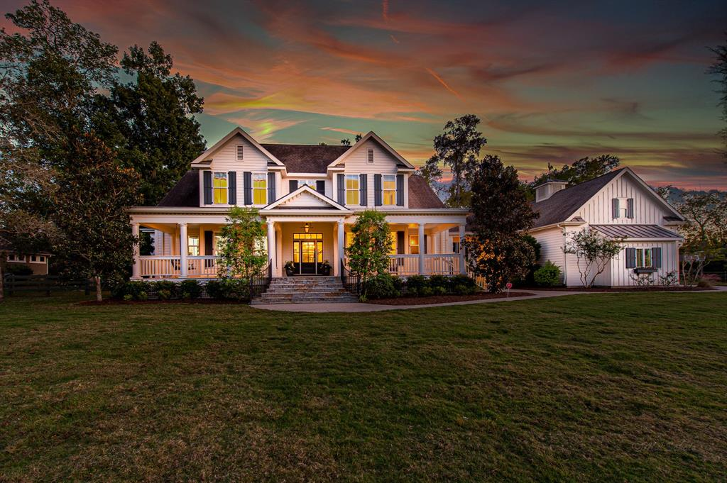 Stunning WATERFRONT gem on a wooded 1-acre lot in the prestigious Fulbrook neighborhood. Step up to the gorgeous front porch straight out of Southern Living and enjoy a glass of sweet tea on the porch swing. As you enter the home, notice the beautiful wainscoting, crown molding, wood and tile floors (2019), and 8-foot tall doors adorned with crystal door handles. Detail continues into the living area with a coffered ceiling, built-in shelves, large windows that showcase nature, and gas log fireplace. Spectacular kitchen area with refrigerator, two drink fridges, and dishwasher that blend seamlessly into the white cabinetry. The large upstairs features three bedrooms with private bathrooms, a vaulted ceiling in the game room, and a second laundry area. Outdoors you'll find mature trees looking out onto water, an outdoor kitchen and fireplace, complete with a pool and spa with travertine deck. Oversized 3-car garage with stairway leads up to open storage room. WELCOME HOME!