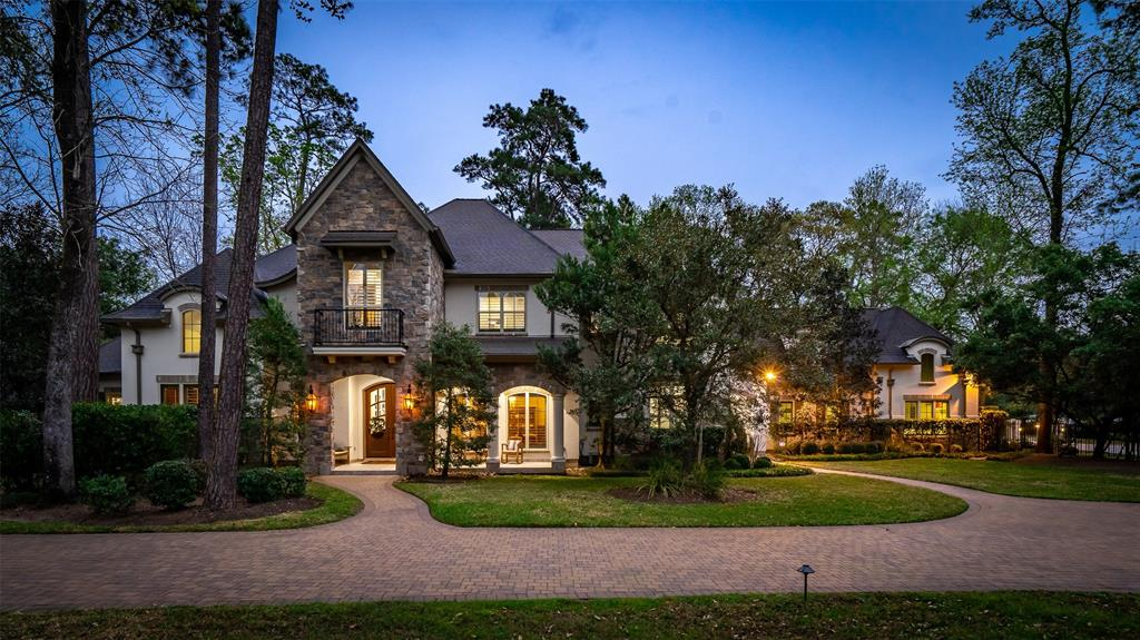This stately home sits on a large lot on a quiet cul-de-sac in Grogan's Point – no problems during storms. The entire property and paved, circular drive are gated. The home features a lush pool and spa , lovely hardwoods, five bedrooms with a guest room and master down. A paneled study and high ceilings with wood beams in the living area with a fabulous kitchen are features of the downstairs with three bedrooms, game room and huge bonus room with a study area, entertainment bar, and a huge closet with tons of built-ins for storage.