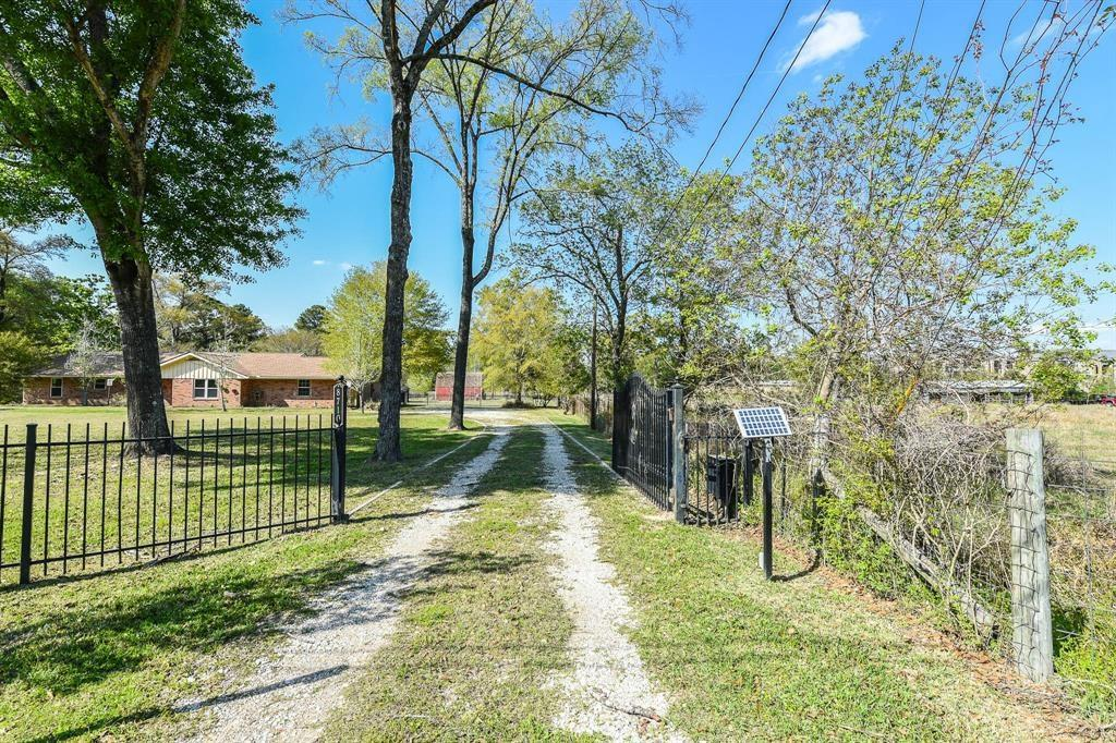 Great Location! 1.5 acres UNRESTRICED Commercial and/or Family used property. Another 3.3 acres land is available for big animals.  The subdivision is just cross street from The Woodlands. It is 0.2 mile from the intersection of the Woodlands Pkwy and FM 2978 and just off FM 2978. Very  close to the Woodlands and all amenities! This is a must see for your business and/or family. This renovated home is all fenced with beautiful landscape. Commercial system expandable in front and backyard.  The house has bedrooms, study, large family room and office/extra room.  Newer septic and patio cover, double pane windows, attic insulated R-45, tile laminate floors, granite counter tops, separated kitchen and family rooms.