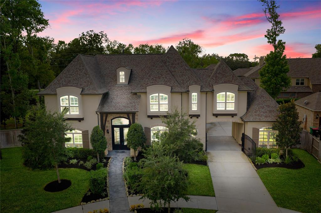 Do you covet luxury, function, and style? Look no further! Magnificently built in 2015, this marvelous 5BR/4.5BA, 5,893sqft home delivers opulence, clever design, and fashionable panache! Resting on 0.42- acres, vernacular architectural details and symmetry are complemented by meticulous landscaping and a color palette evoking old-European charm. Discover an exquisite interior with soaring ceilings, an open floor plan, an orb chandelier, a two-story family room fireplace, and a gourmet kitchen fit for the finest chefs, which includes stainless steel appliances, built-in refrigerator($8K+option), sprawling center island, custom cabinetry, and gas range. Be pampered daily in the master bedroom featuring an enviable walk-in closet and a jaw-dropping en suite w/walk-through shower and soaking tub! Other features: 3-car garage, gated private parking, whole home built-in vacuum system, outdoor kitchen w/fireplace and grill, 700+sqft garage apartment, and so much more! Call now for your tour!