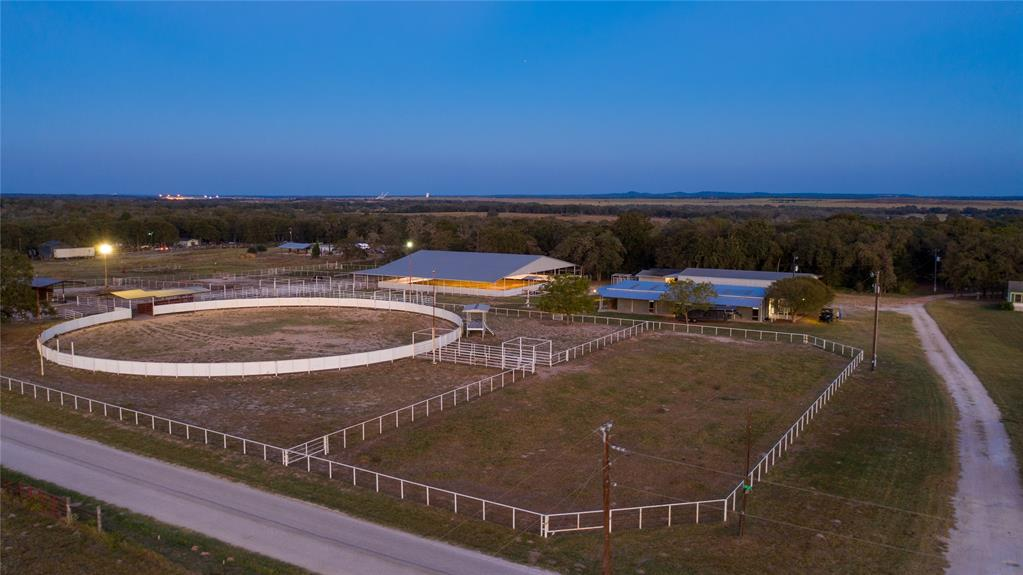 EQUESTRIAN FACILITY, FARM & RESIDENCE  The Abel equine facility and Farm is a top-tier professional equine training and boarding facility. Facilities such as this are simply rare and do not often come to market. Just 29 miles from the Texas State Capitol in Austin and minutes outside of the thriving small town of Elgin, this property is within reach. The Abel Equine Facilities and Farm is a recreational and residential paradise for a discerning horse enthusiast eager to enjoy all that the property has to offer.  The main home sits tucked away and is 3 bed / 2 bath. The property could serve as a full time or part-time residence for the new owner.  The land is flat, with a gentle slope. Between the horse facility and the +- 20 acres of Tifton and coastal improved pasture, this property feels much larger than it is! The property has 2 entrances, providing an opportunity for long term hold in the future.  turn-key horse facility - reach out for a full list of improvements!