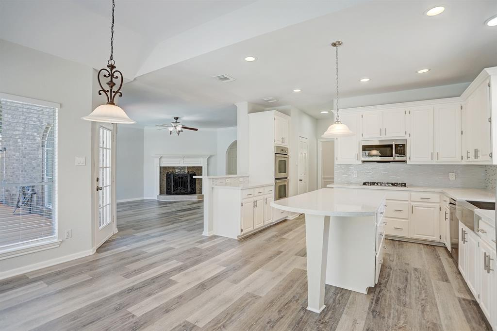 Stunning renovated home w/Lake view in desirable New Territory/Blakely Bend.Boasting 3,547sqft 5 beds+Game room,Formal Living&Dining,3-Car Garage w/oversized driveway&Pool.Complete Renovation Sep2020.Full Kitchen Remodel!Engineered Wood Floors throughout 1st&2nd flr!This home is larger than most homes 5 Beds+3 Car Garage!Master Bedrm 1st flr!Step inside the foyer  greeted by the glistening chandelier&curved wrought iron staircase!Stylish Island kitchen boasts stainless appliances,gas cooktop,double oven,farm house sink,Quartz Countertops,backsplash,bar seating&breakfast area.Open family rm w/pool view.Owner's Retreat-w/wood flrs,luxurious en-suite spa like bath w/oversized travertine shower&surround walls,tub,dual vanities w/granite counters w/mosaic tiles.Two walk-in closets.2nd flr  Loft/Game Rm,4 beds w/en-suite baths.Relax on your deck or splash into your Pool w/lush landscaping.Pool-resurfaced(Sept2018).Roof –March 2018.A/C(2016).Walk across to the playground&Gazebo.Virtual Tour