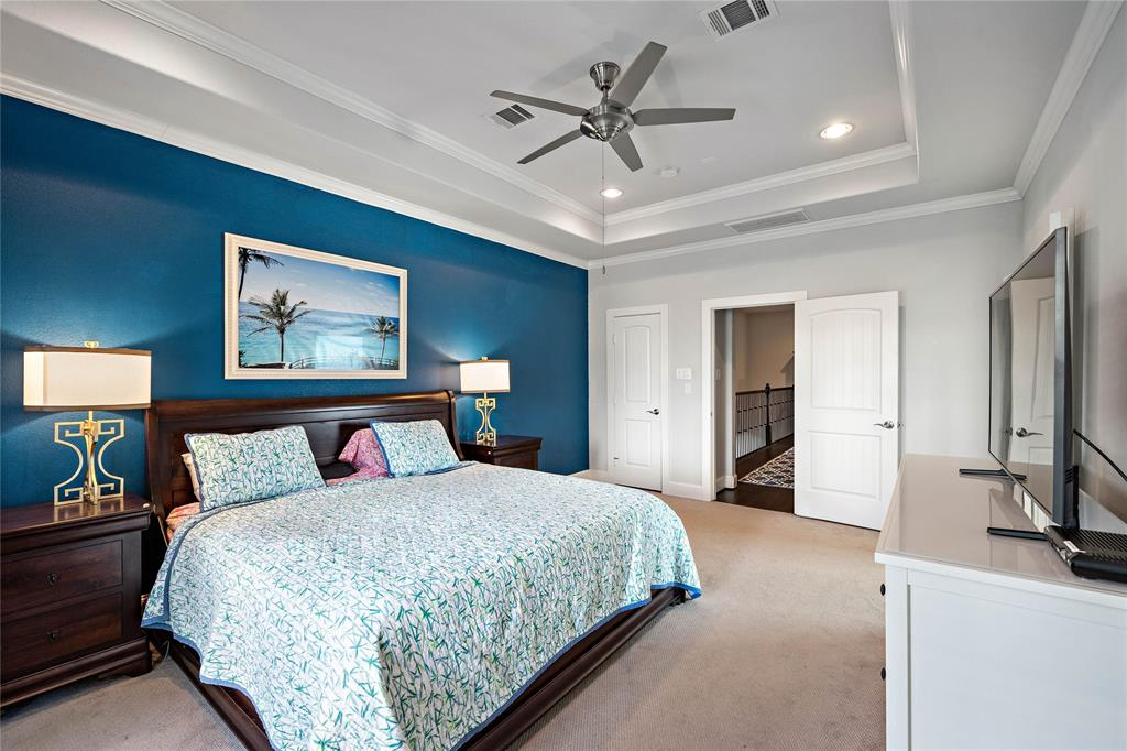 Another view of the large primary bedroom with beautiful vaulted ceilings.