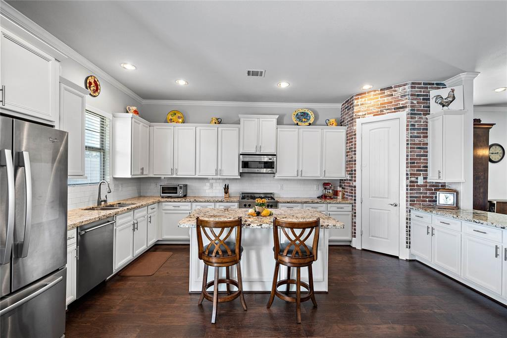 This kitchen comes with both a peninsula bar as well as an island ready for cooking and entertaining.