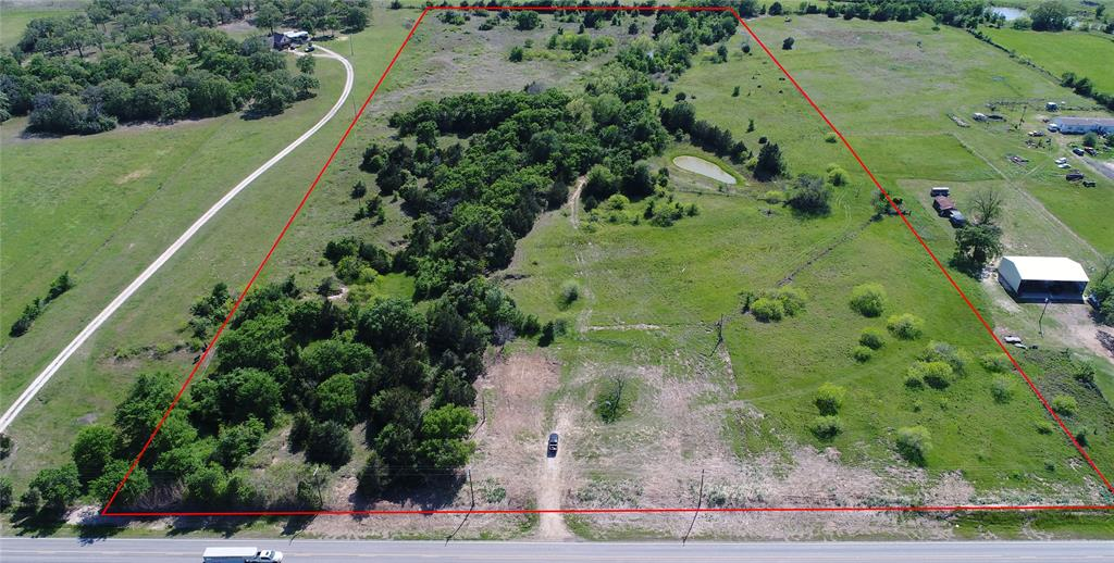 This nice tract of land offers peaceful country living and will provide a great place for a home or to graze a few animals. The property is minutes from Caldwell and major highways 21 and 36 providing easy access to Bryan, College Station, Brenham and is one hour from Austin. The plat of the property provides a good location to build your DREAM HOME in the front or in the back that offers even more privacy. The terrain is mostly level with a pond and scattered trees. The property is fenced on four sides. Electricity on property, Deanville Water Corp. and Septic is in place! Potential end use of this tract of land is excellent for a home or investment for future use.