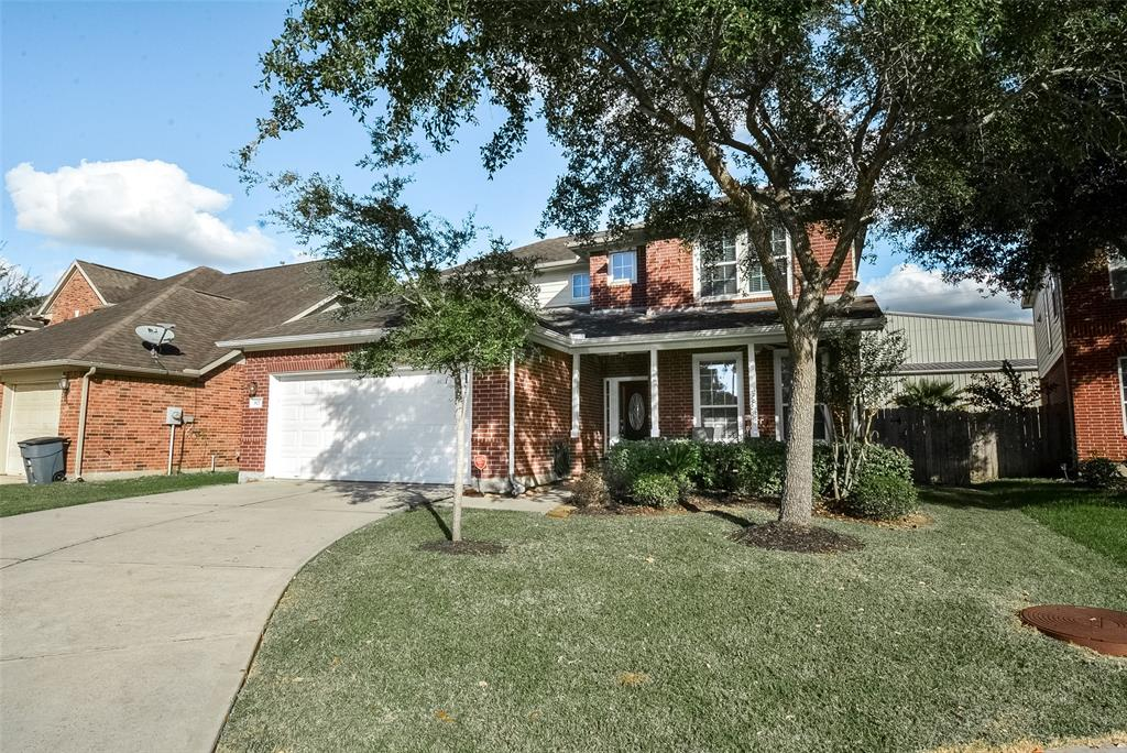 Great one owner home with great extras. Low Stafford Taxes in Fort Bend schools!  Brick on all 4 sides of the downstairs. Front porch where you can sit outside and enjoy this beautiful weather! Tile entry, high ceilings, granite counters in kitchen with gas cooking. Great breakfast room & kitchen with granite counter also attached to the den with corner gaslog fireplace. Freshly painted, super clean, double pane windows, cul-de-sac, shower and separate jetted tub in downstairs master with glass block window. Upstairs gameroom. Zoned ACs & heat, sprinkler system. Formal dining, utility room close to master downstairs for easy access. Great home at the bend of the cul-de-sac. Come see. Includes washer, dryer and refrigerator.